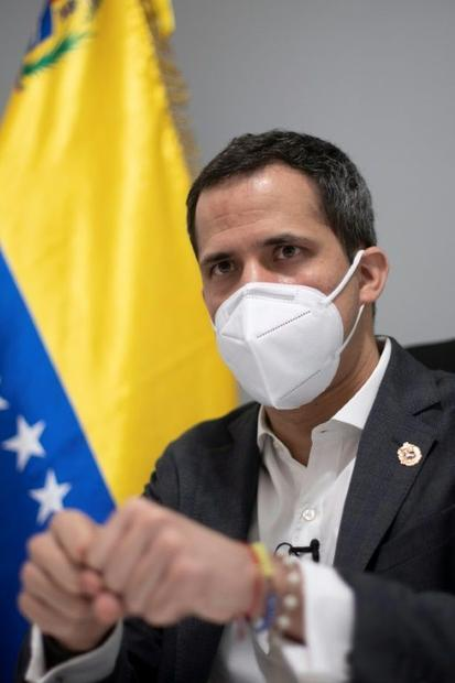 Venezuelan opposition leader Juan Guaido gestures during an interview with AFP at his home in Caraca...