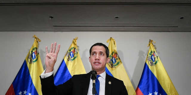 Venezuelan opposition leader Juan Guaido speaks at a press conference in Caracas, Venezuela, Saturday, Dec. 5, 2020, a day before parliamentary elections. (AP Photo/Matias Delacroix)