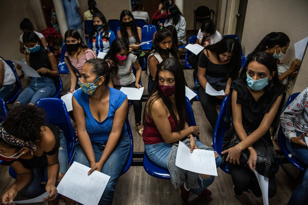 Women waiting to receive contraceptive implants at a low-cost women's clinic in Caracas. Abortion is illegal in most cases in Venezuela, and the economic and humanitarian crisis in the country has curtailed access to birth control.